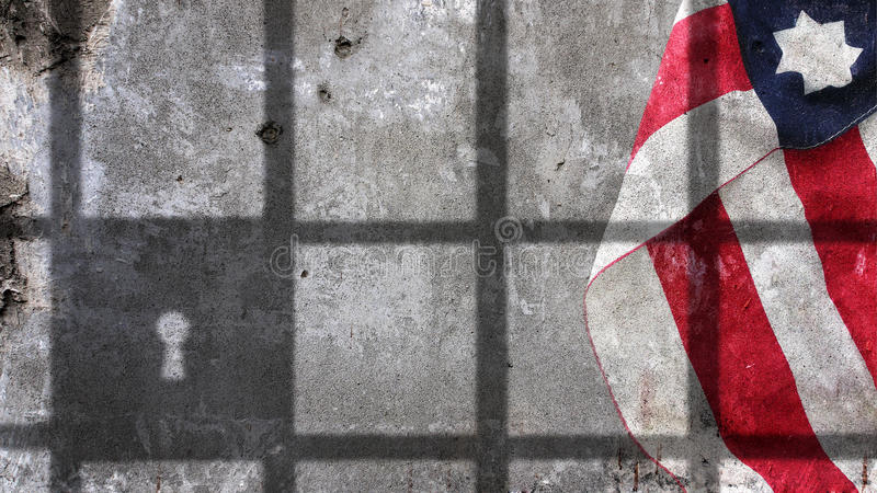 Usa Flag Under Jail Bars. On Concrete Wall royalty free stock photography