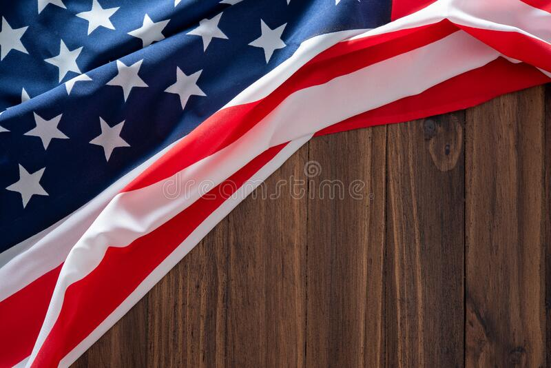 USA flag on wooden table for background royalty free stock images