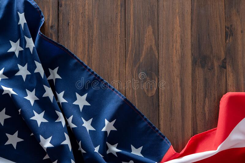 USA flag on wooden table for background stock photography