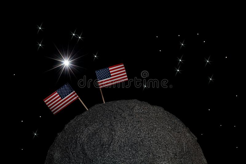 USA going back to the moon. Two American flags on the lunar surf. USA going back to the moon. Two American flags on the surface of a model moon in space with royalty free stock photos
