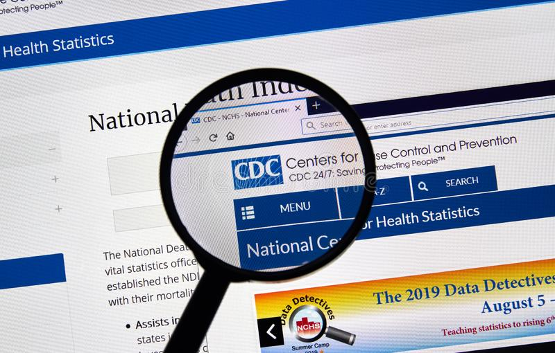 USA Government home page. MONTREAL, CANADA - APRIL 24, 2019 : CDC.gov USA Government home page under magnifying glass. CDC.gov is the US official Web site of the royalty free stock image