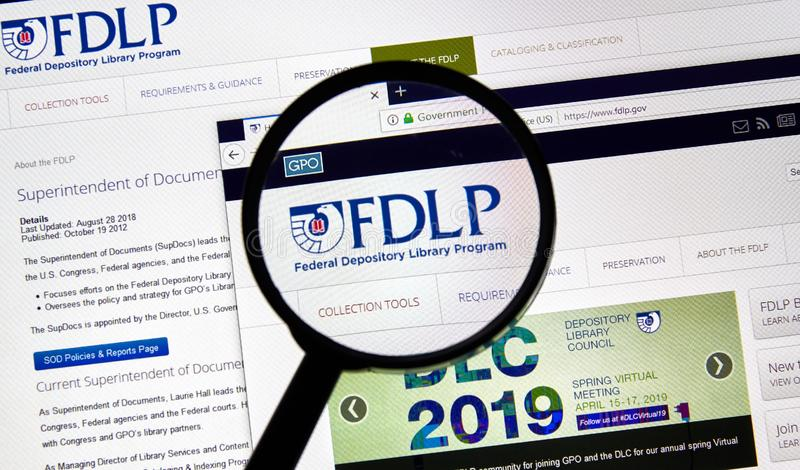 USA Government home page. MONTREAL, CANADA - APRIL 24, 2019 : FDLP USA Government home page under magnifying glass. Federal Depository Library Program FDLP is a stock photography
