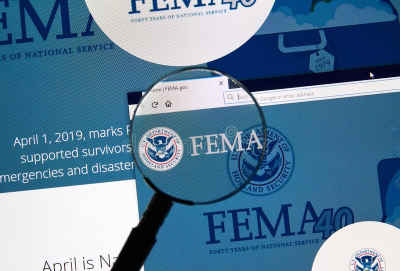 USA Government home page. MONTREAL, CANADA - APRIL 24, 2019 : Fema.gov USA Government home page under magnifying glass. FEMA is The Federal Emergency Management stock image