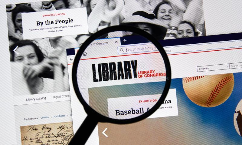 USA Government home page. MONTREAL, CANADA - APRIL 24, 2019 : Loc.gov Library of Congress USA Government home page under magnifying glass. The Library of royalty free stock photos