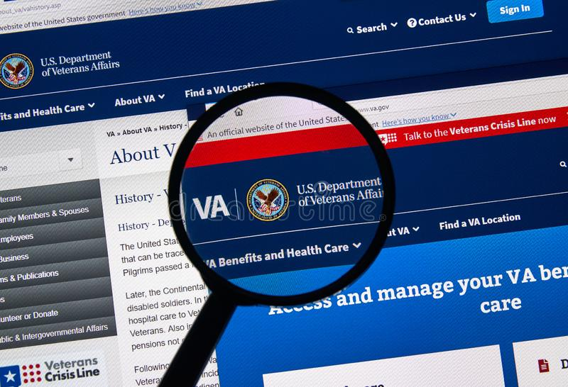 USA Government home page. MONTREAL, CANADA - APRIL 24, 2019 : va.gov USA Government home page under magnifying glass. Va.gov is the official web site of US stock photography