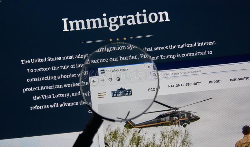 USA Government home page. MONTREAL, CANADA - APRIL 24, 2019 : USA White House Government Immigration home page under magnifying glass. Whitehouse.gov is the stock photography