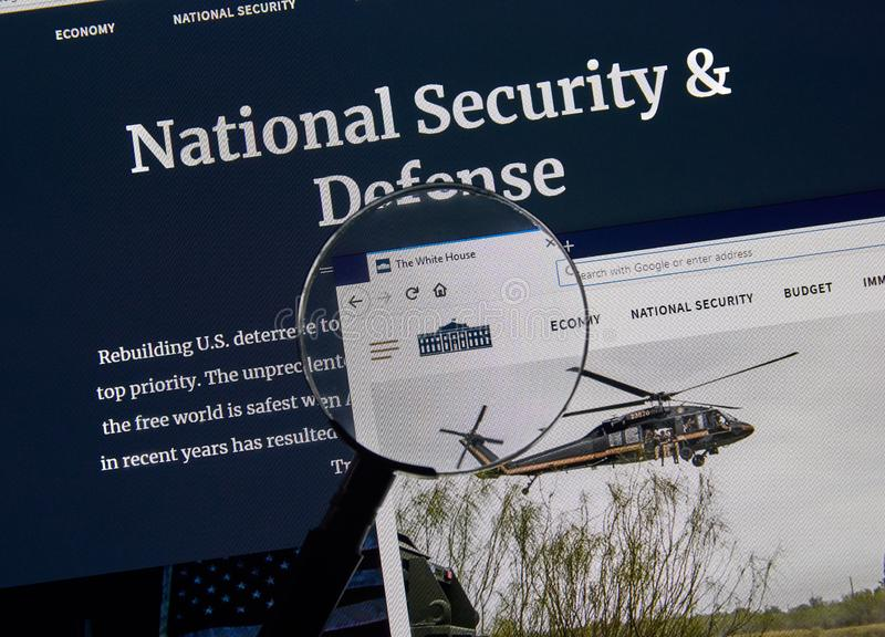 USA Government home page. MONTREAL, CANADA - APRIL 24, 2019 : USA White House National Security and Defense Government home page under magnifying glass royalty free stock photography
