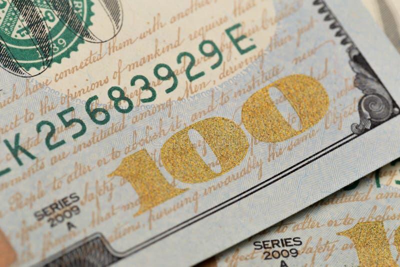 USA hundra dollarbest?ndsdelar, toppen makro, st?nger sig upp fotoet arkivfoton