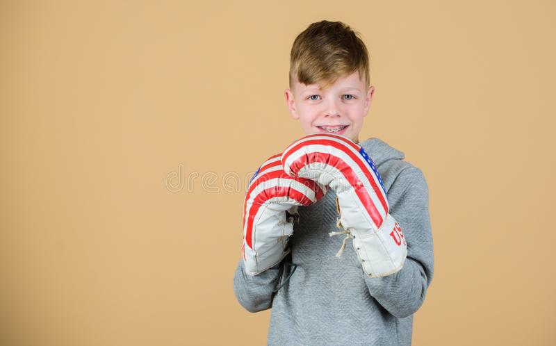 Usa independence day. Happy child sportsman in boxing gloves. Fitness diet. energy health. workout of small boy boxer. Punching knockout. Working his core royalty free stock photos