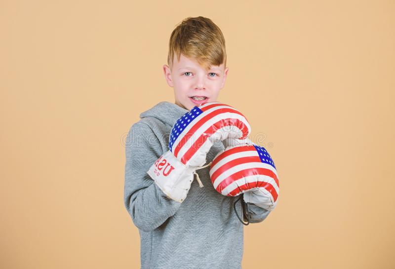 Usa independence day. Happy child sportsman in boxing gloves. workout of small boy boxer. punching knockout. Satisfied. With his work out. Fitness. energy royalty free stock photography