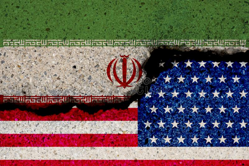 USA and Iran flag print screen on cracked wall damage. United state of America and Iran have conflict in nuclear weapons and. Strait of Hormuz royalty free stock images
