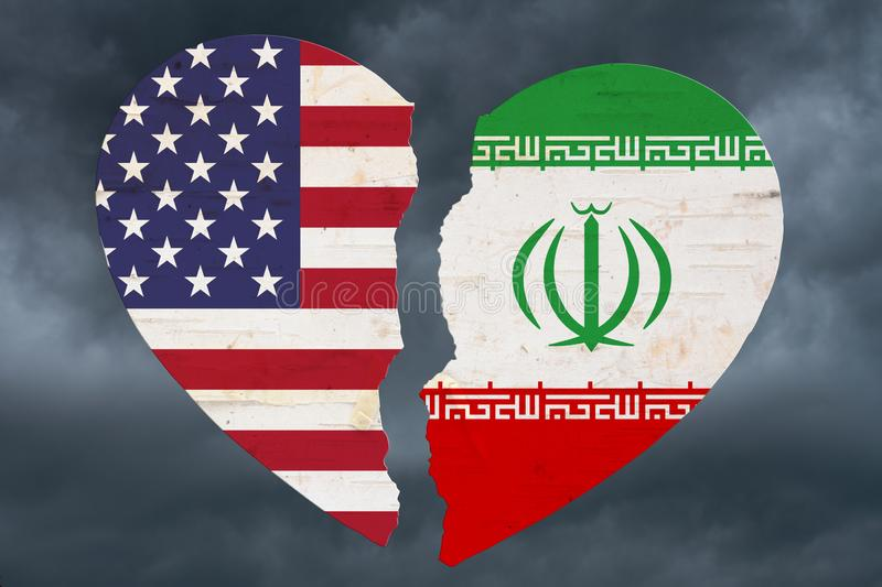 USA and Iran flags in a broken heart. With stormy sky background stock images
