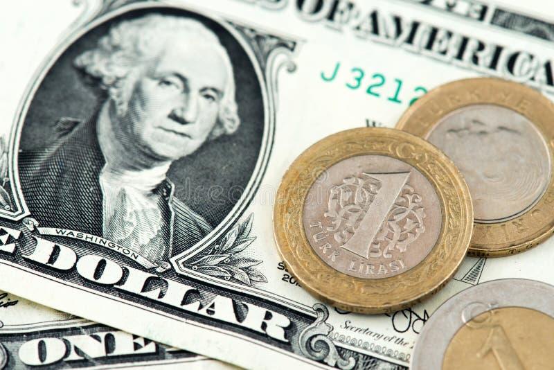 USA Jeden dolara banknoty i Tureckiego lira monety zdjęcie stock