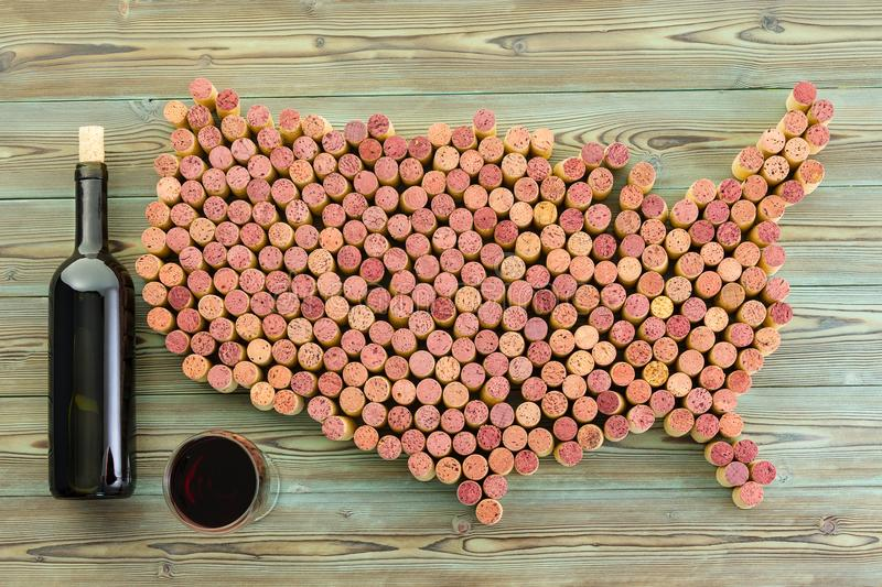USA map of old wine corks with bottle and glass stock photo