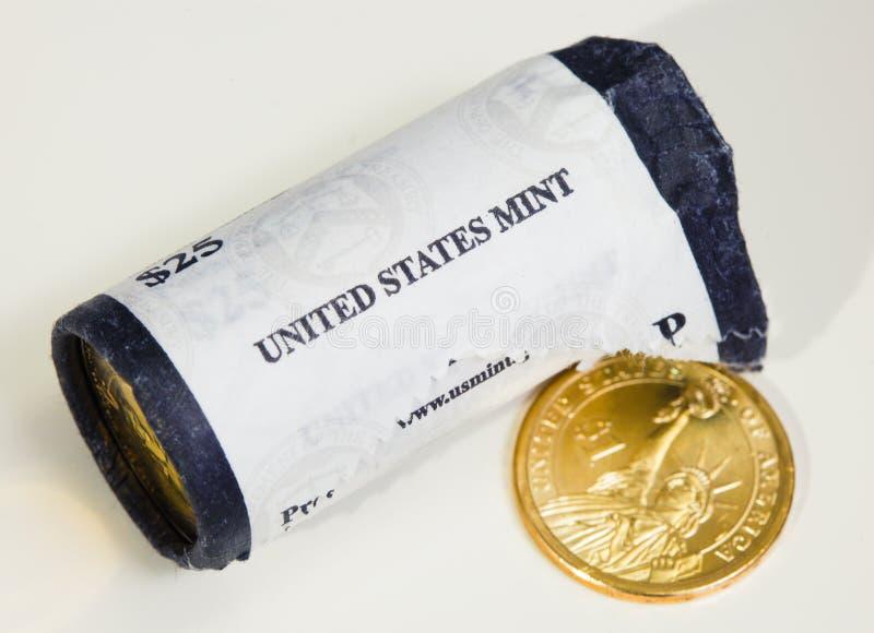 USA-mintkaramellrulle av presidents- dollarmynt arkivbilder