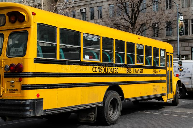 USA, New York - 13 April 2015: Closeup of classic yellow school bus parked on the street of the city stock photography
