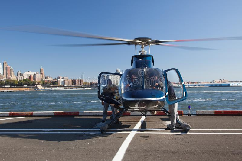 Usa, New York. Blue  helicopter  close up with unknown persons on the background of New York NYC . stock image