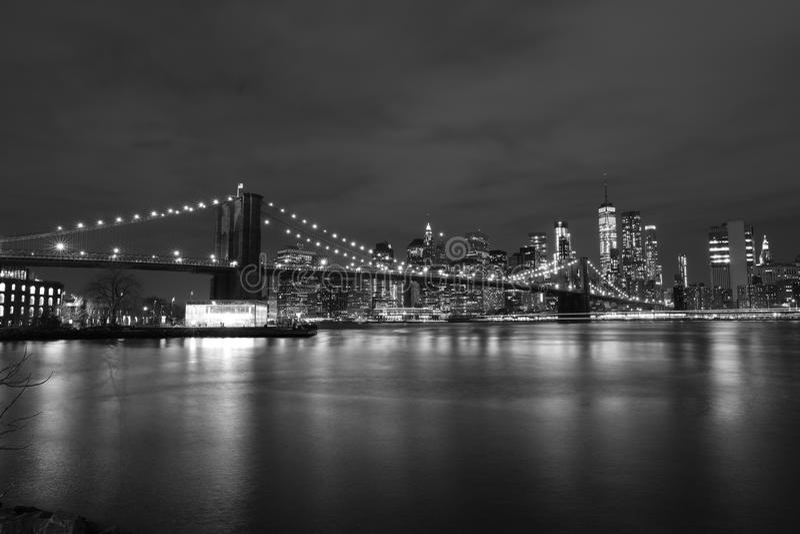 Brooklyn Bridge at night, black and white royalty free stock image