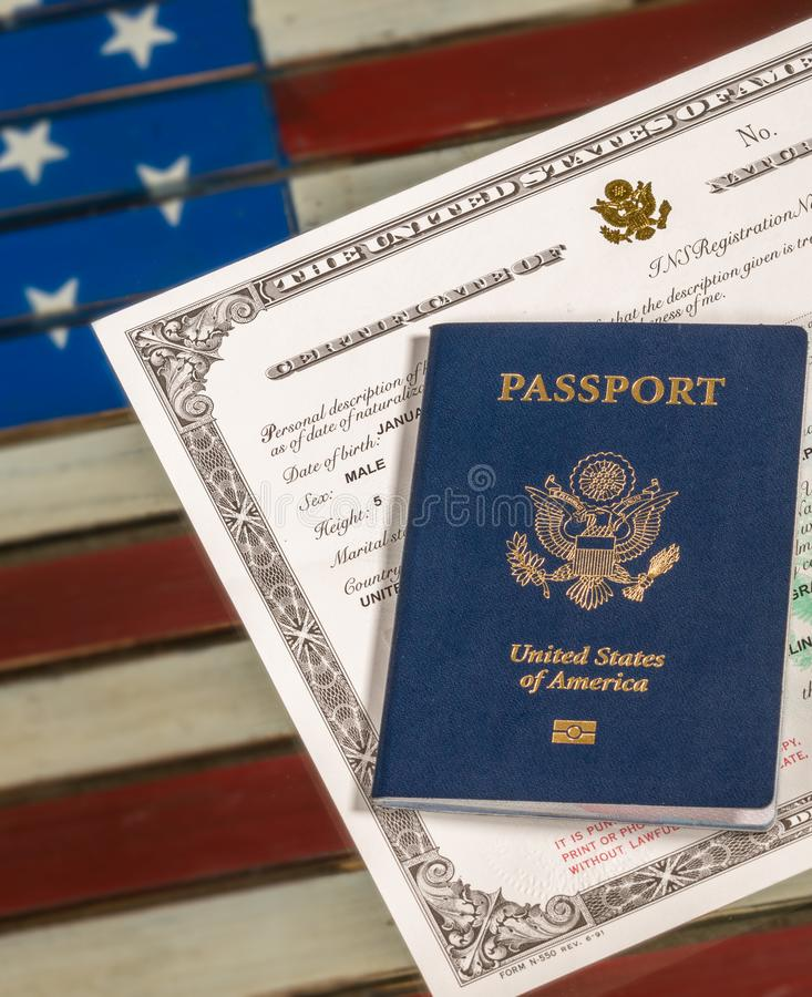 Usa Passport And Naturalization Certificate Over Us Flag Stock Photo