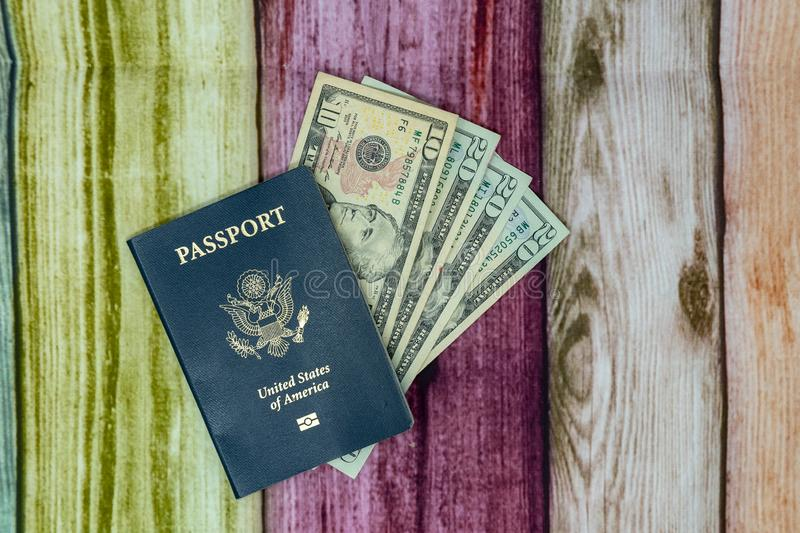 USA passport with United States of America currency money. Concept for travel, international, budget stock photography