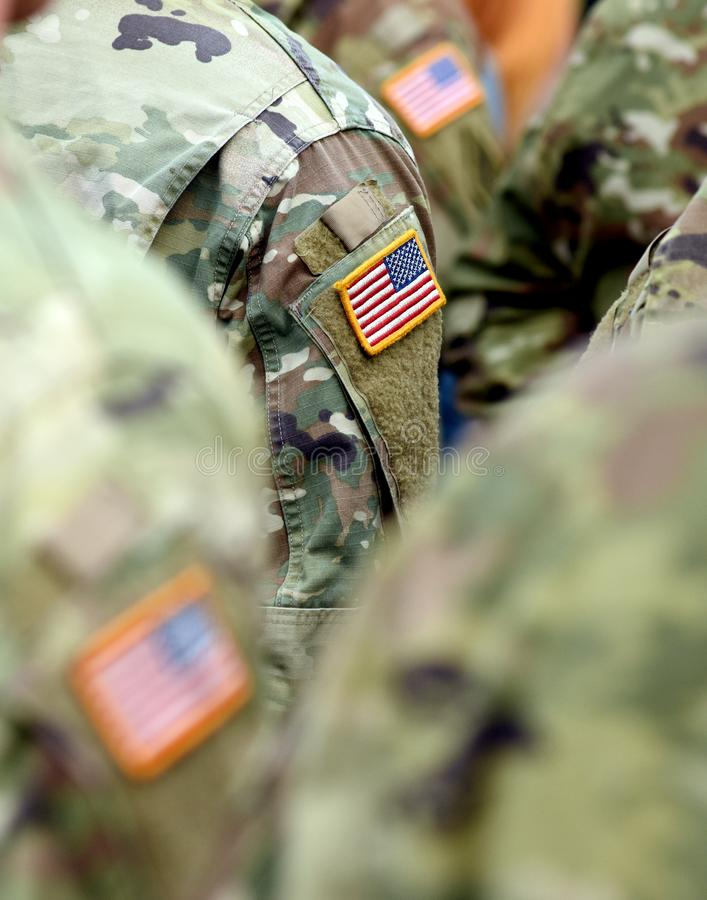USA patch flag on soldiers arm. US troops stock photo