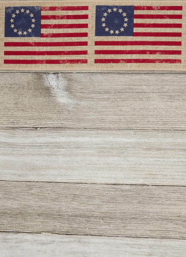 USA patriotic Betsy Ross old flag on a weathered wood background. With copy space for your message royalty free stock photo