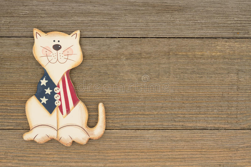 USA patriotic fun cat on a weathered wood background stock image