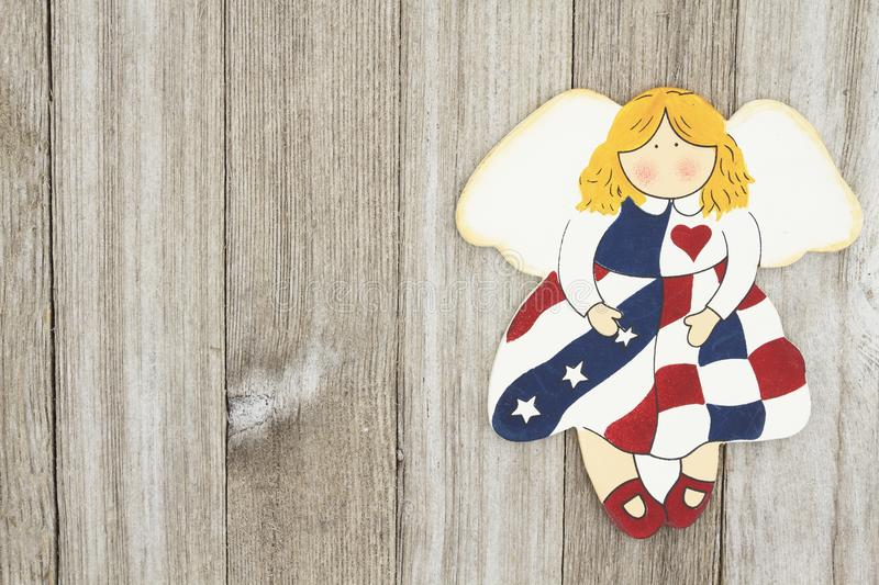 USA patriotic old flag on an angel on a weathered wood background. With copy space for your message royalty free stock photos
