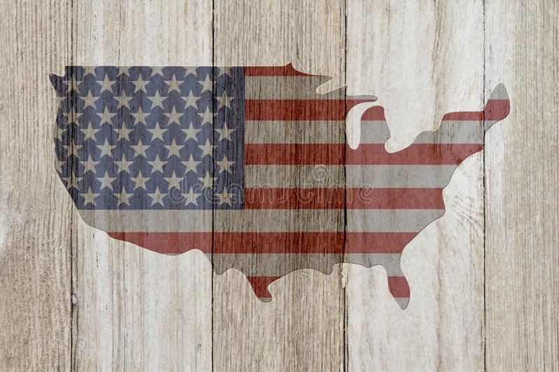 USA patriotic old flag on a map and weathered wood background. USA patriotic old flag on a map with weathered wood background with copy space for your message royalty free stock photo
