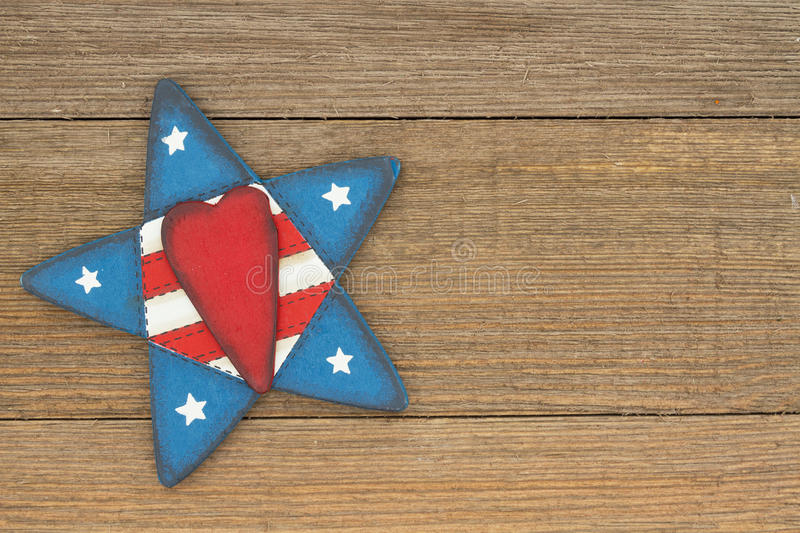 USA patriotic old flag on a star and weathered wood background. USA patriotic old flag on a star with weathered wood background with copy space for your message royalty free stock images
