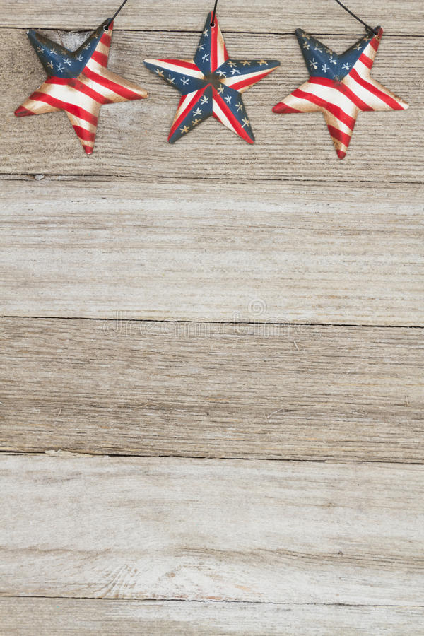 USA patriotic old flag on a stars and weathered wood background. USA patriotic old flag on a stars with weathered wood background with copy space for your royalty free stock image
