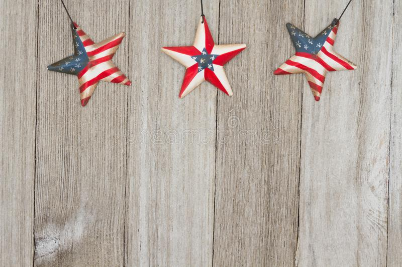 USA patriotic old flag on a stars and weathered wood background. USA patriotic old flag on a stars with weathered wood background with copy space for your royalty free stock images