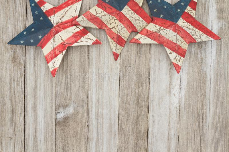 USA patriotic old flag on a stars and weathered wood background. USA patriotic old flag on a stars with weathered wood background with copy space for your stock photography