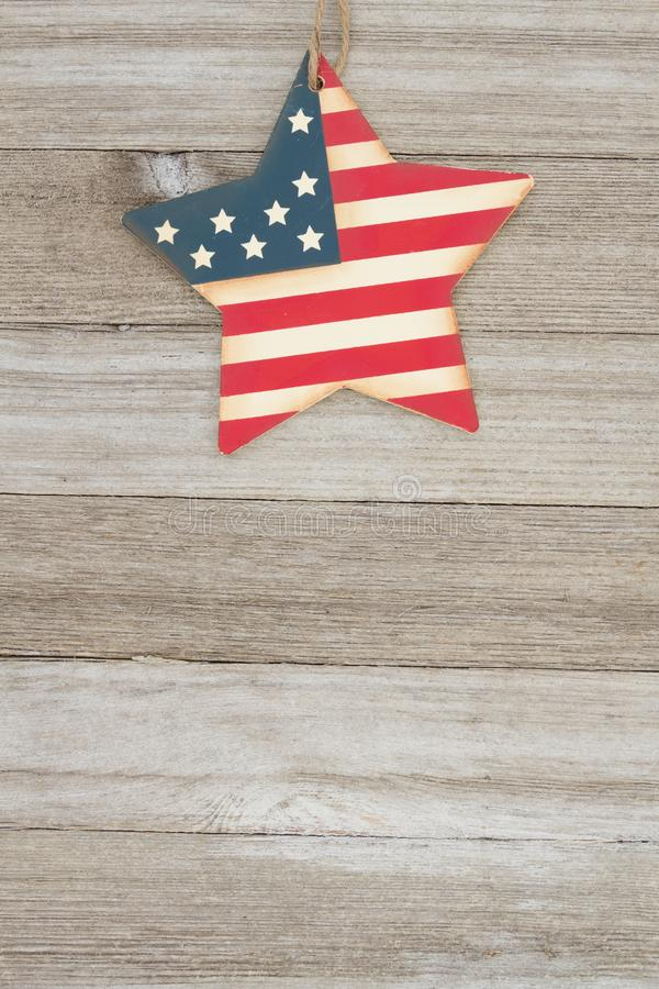 USA patriotic old flag on a stars and weathered wood background. USA patriotic old flag on a star with weathered wood background with copy space for your message royalty free stock image
