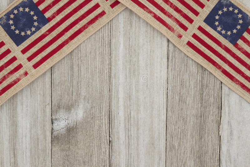 USA patriotic old flag on a weathered wood background. With copy space for your message stock photos