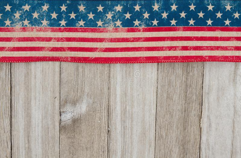 USA patriotic old flag on a weathered wood background. With copy space for your message royalty free stock image