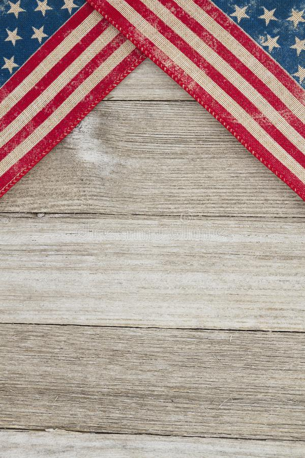 USA patriotic old flag on a weathered wood background. With copy space for your message stock images