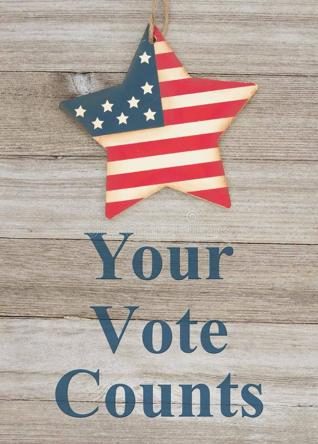 USA patriotic voting message Your Vote Counts. USA patriotic voting message, USA patriotic old flag on a star with weathered wood background with text Your Vote royalty free stock photos