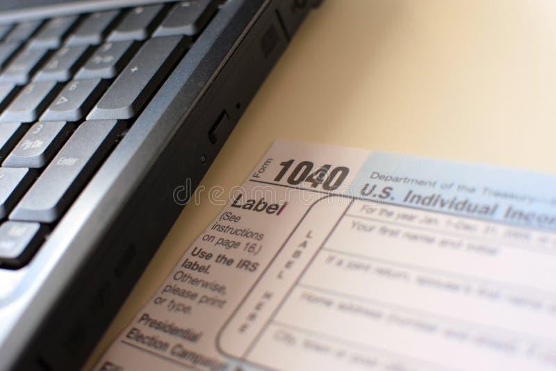 USA podatku forma 1040 i laptop zdjęcia stock