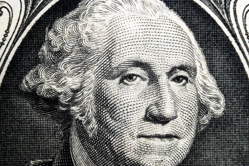 USA-presidenten George Washington vänder mot ståenden på USA en dollaranmärkning Skjuten makro Bakgrund av pengarna Ey George Was royaltyfri bild