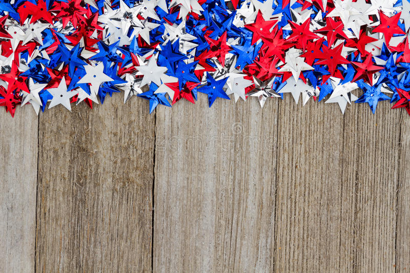 USA red, white and blue stars on weather wood background stock images