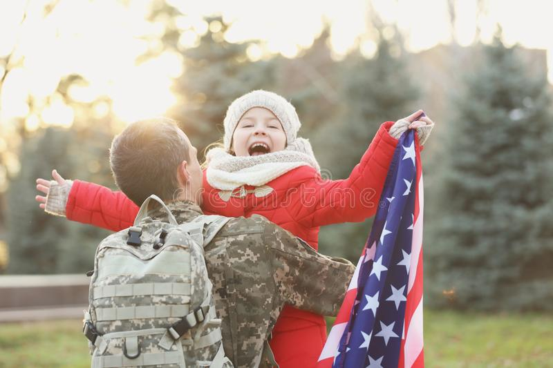 USA soldier hugging his daughter royalty free stock photos