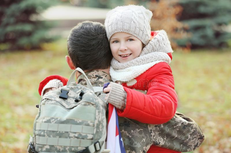 USA soldier hugging his daughter royalty free stock photo