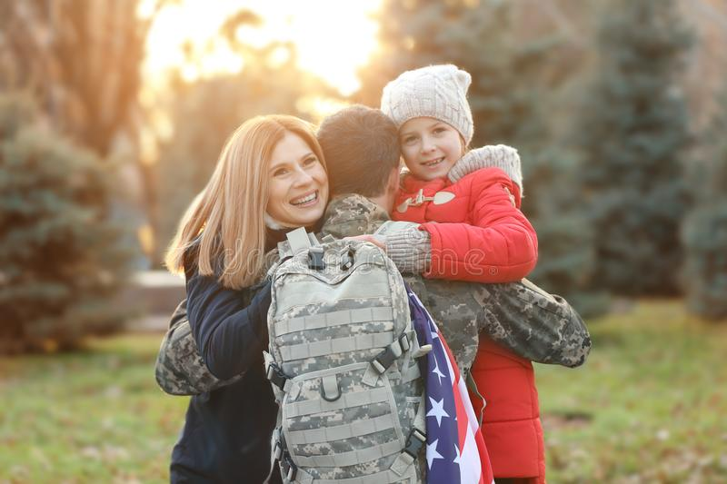 USA soldier hugging his family royalty free stock photography