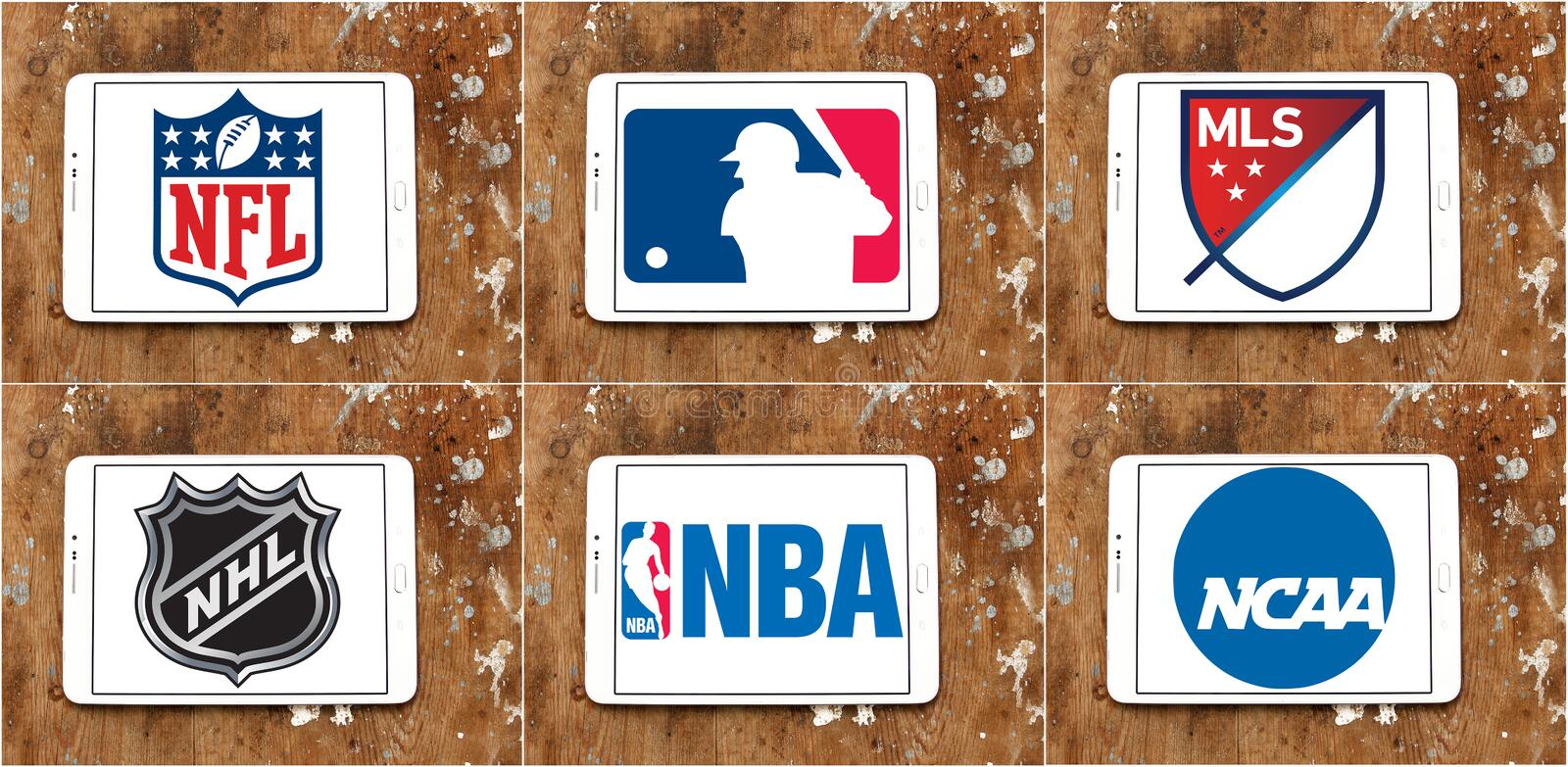 Usa sports logos and icons. Collection of logos and vector of most popular usa sports leagues on white tablet on rusty wooden background. leagues like nfl, mls