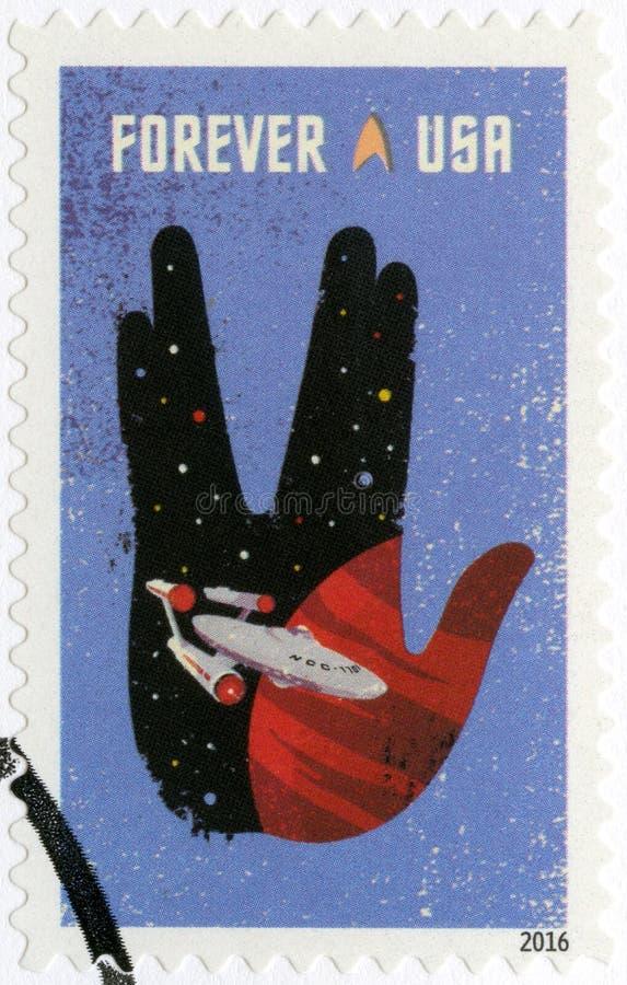 USA - 2016: visar företaget inom översikten av den Vulcan honnören, Spock iconic handgest arkivfoto