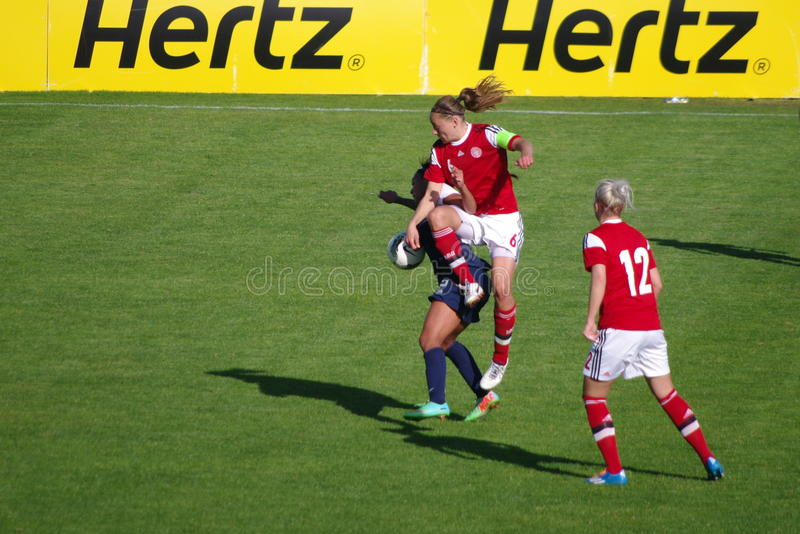USA vs Denmark. Sydney Leroux USA) protects the ball from danish player Mariann Knudsen, 3rd day of the 2014's Algarve Cup royalty free stock image