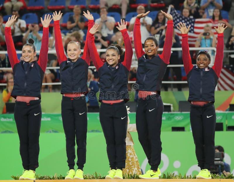 USA women's all-around gymnastics team at Rio 2016 Olympic Games Raisman (L), Kocian, Hernandez, Douglas and Biles. RIO DE JANEIRO, BRAZIL - AUGUST 9, 2016: Team royalty free stock image