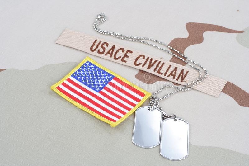 USACE CIVILAN branch tape with dog tags and flag patch on desert camouflage uniform stock photos