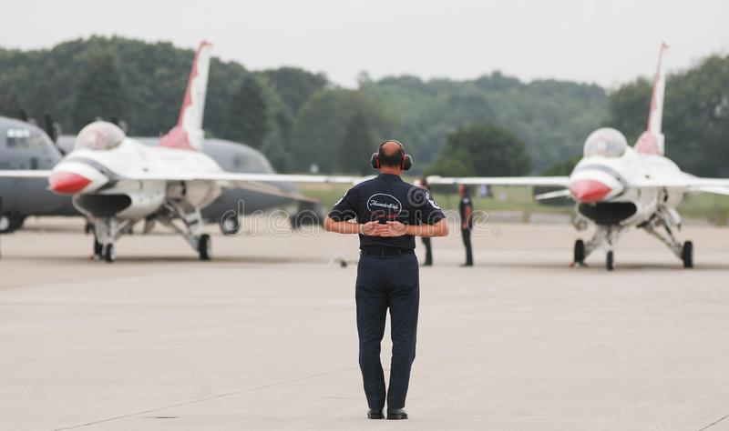 USAF Thunderbird ground team. Members of the USAF Thunderbirds ground team, go through the take off routine prior to performance at Quonset Point in North royalty free stock photos